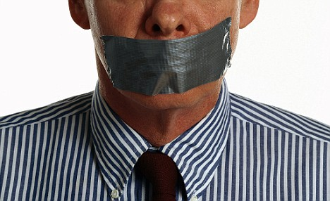 Businessman with Taped Mouth --- Image by © Larry George/Corbis